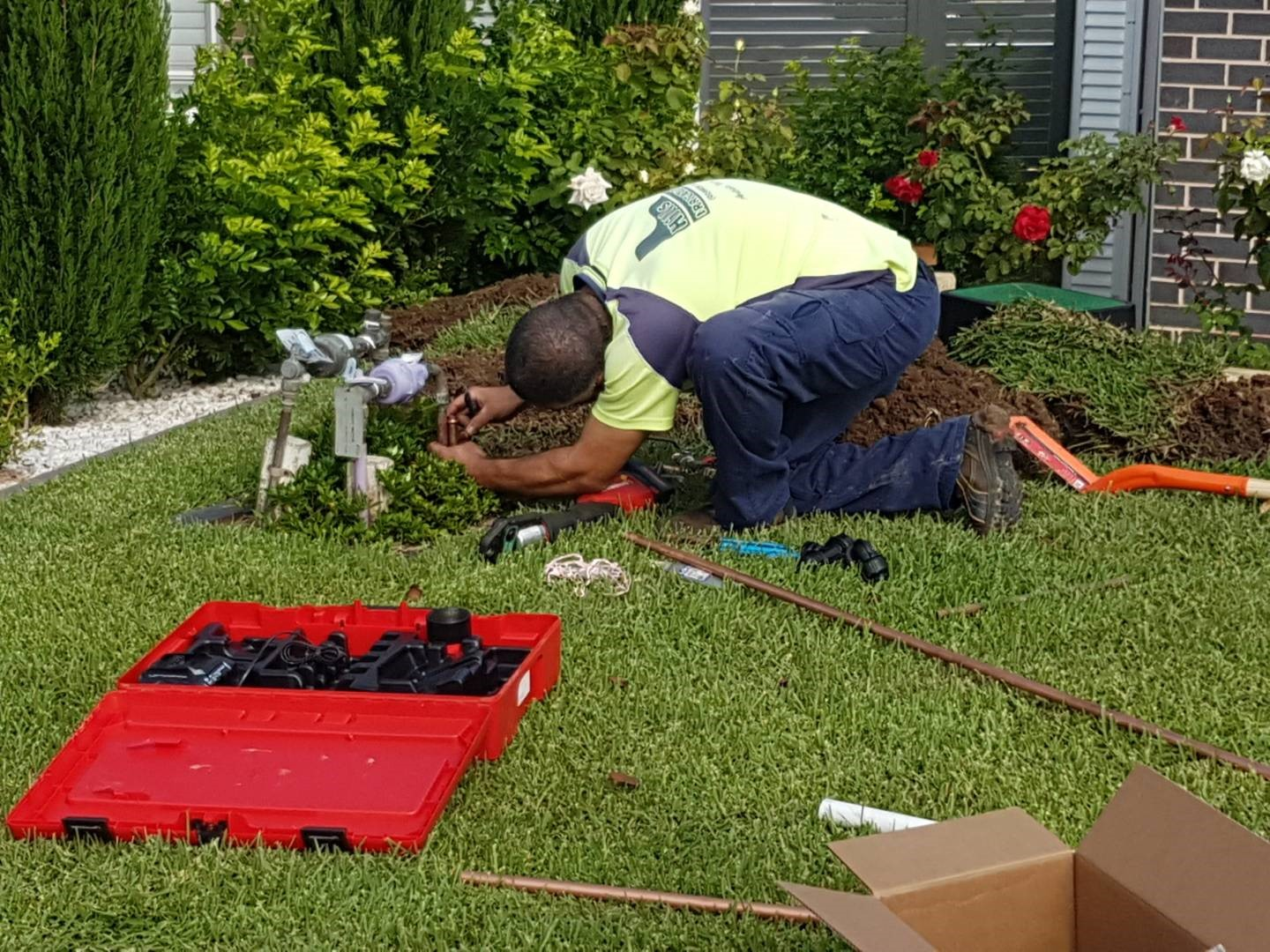A Hills Irrigation professional installing a backflow in an irrigation system