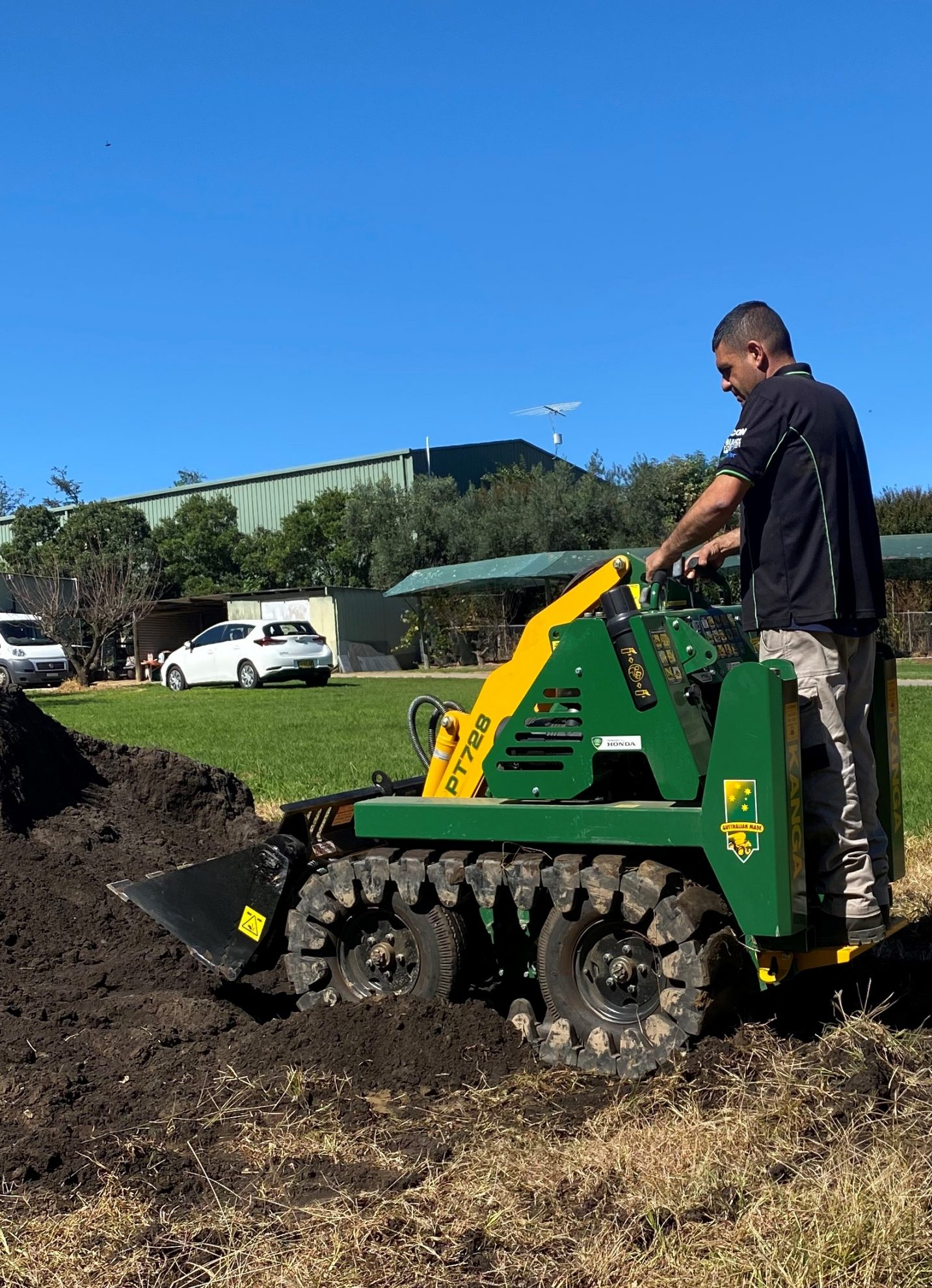 A Hills Irrigation professional trenching land